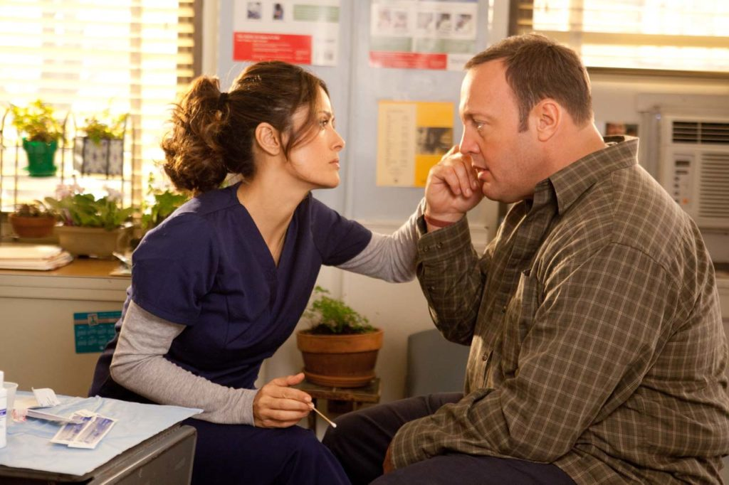 The school nurse Bella (Salma Hayek) washes out a small cut on Scott (Kevin James) in Columbia Pictures' HERE COMES THE BOOM.