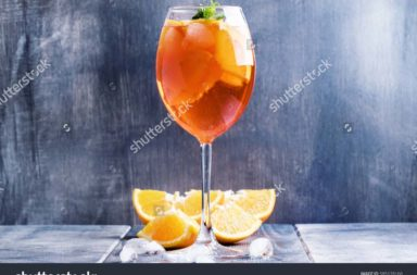 stock-photo-summer-cocktail-aperitif-with-orange-bitter-fruit-ice-and-soda-in-tall-glass-gray-silver-585178168