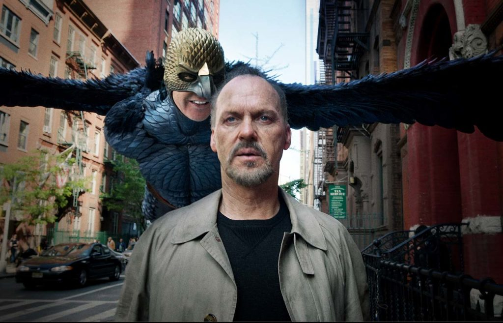 In Birdman, Michael Keaton plays both the actor Riggan Thomson, who is having an identity crisis, and his alter ego, Birdman, who badgers him because he gave up a lucrative Hollywood career for a play in an old Broadway theater.